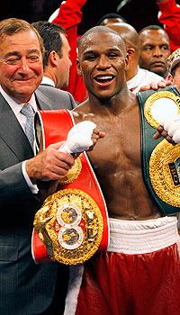 Bob Arum (L) and Floyd Mayweather Jr. had an acrimonious split in 2006 after working together for 10 years (File photo)