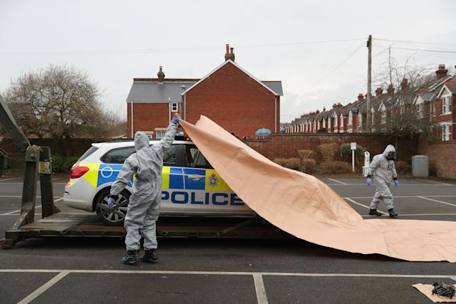 A police car being taken away by military personnel from College Street Car Park in Salisbury, as police and members of the armed forces probe the nerve agent attack on Sergei Skripal.