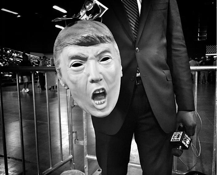 <p>A journalist holds a Donald Trump mask he was using as a prop ahead of a campaign rally on June 14 in Greensboro, N.C. (Photo: Holly Bailey/Yahoo News) </p>
