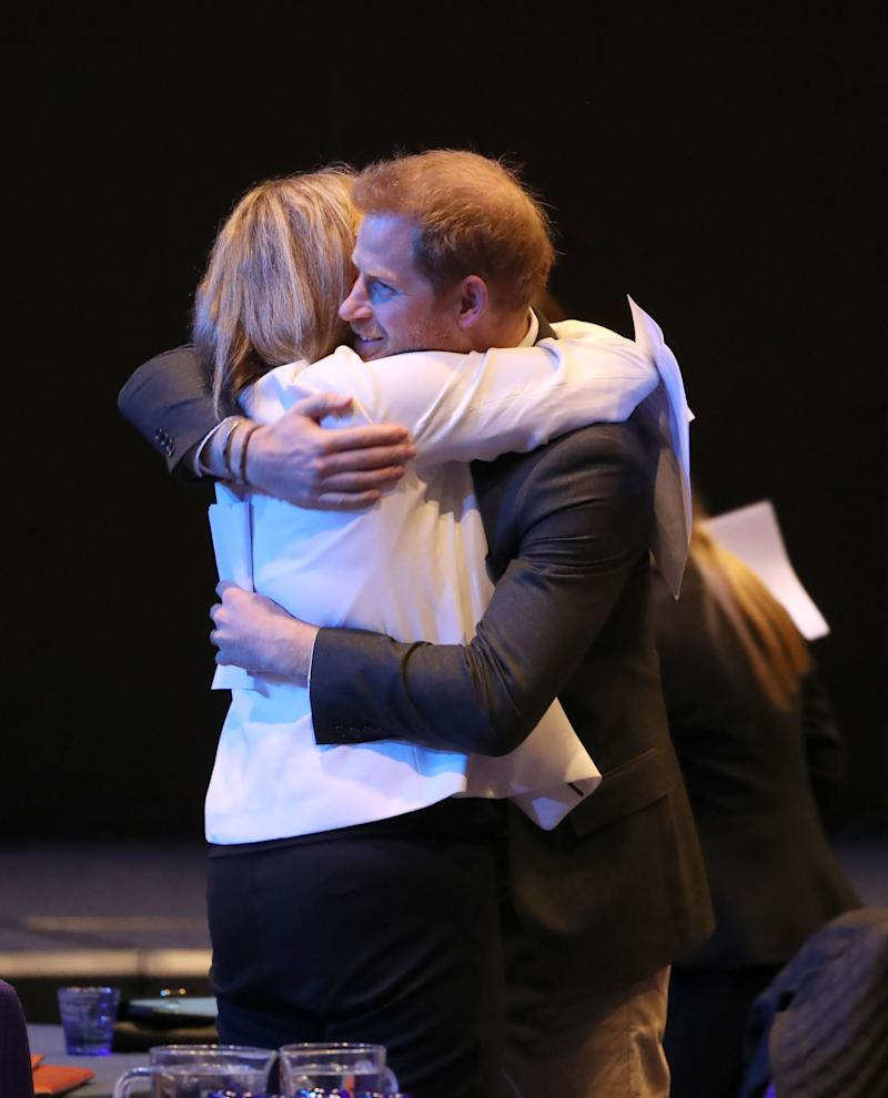 The Duke of Sussex is hugged during a sustainable tourism summit at the Edinburgh International Conference Centre in Edinburgh. (Photo by Andrew Milligan/PA Images via Getty Images)
