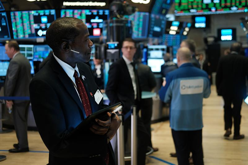 NEW YORK, NEW YORK - FEBRUARY 12: Traders work on the floor of the New York Stock Exchange (NYSE) on February 12, 2020 in New York City. The market closed up over 250 points as gains in tech companies and retailers outweighed concerns over the coronavirus. (Photo by Spencer Platt/Getty Images)