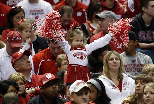 A young Wisconsin fan cheers during the first half of a second-round game between the Wisconsin and the American in the NCAA college basketball tournament Thursday, March 20, 2014, in Milwaukee. (AP Photo/Jeffrey Phelps)