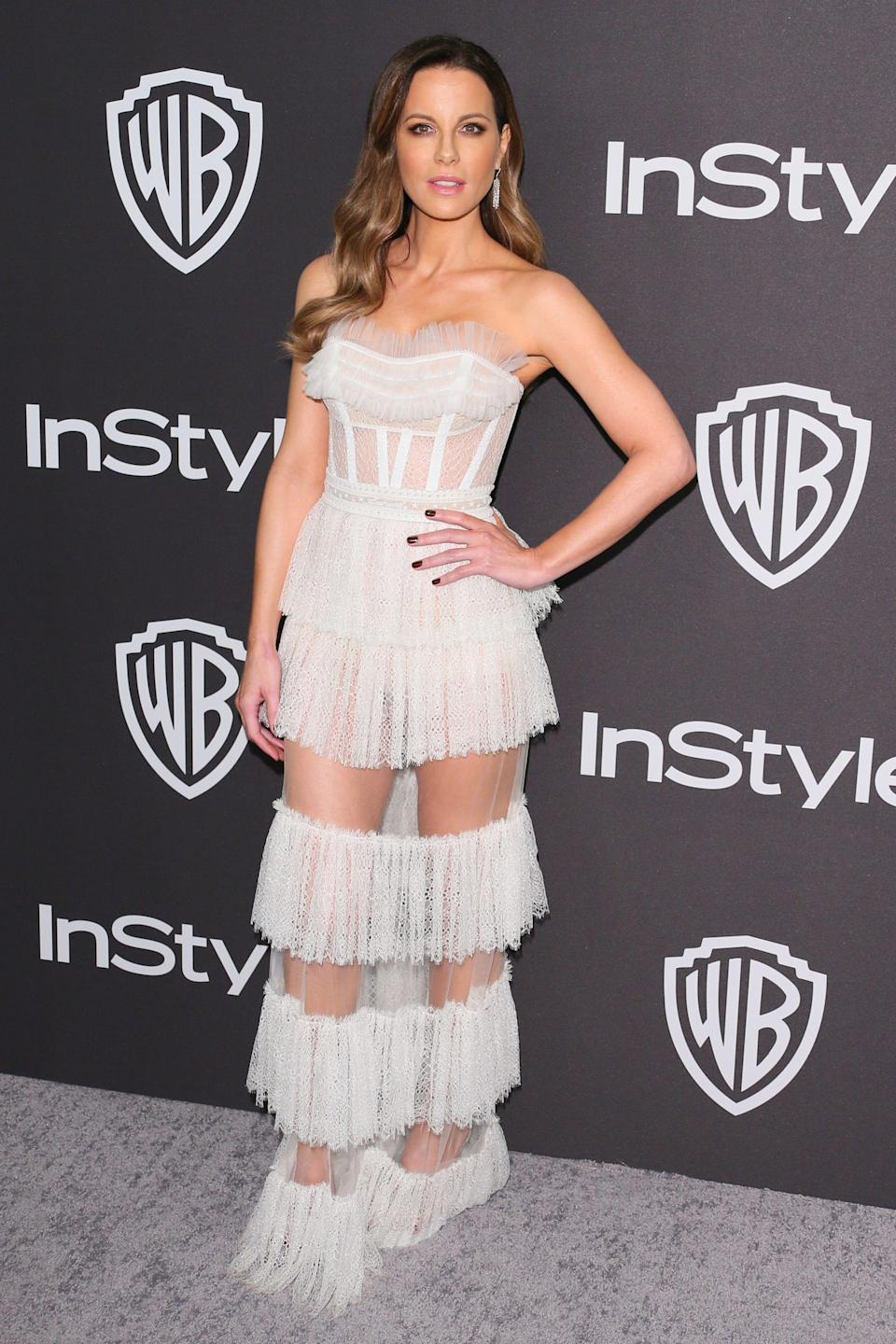 <p>Wearing a sheer panelled dress finished with Stuart Weitzman shoes. <em>[Photo: Getty]</em> </p>