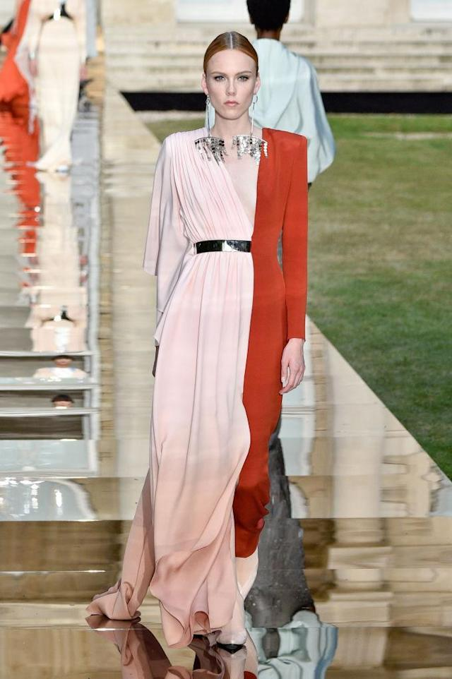 <p>Model wears an orange and blush pink contrast gown from the Givenchy fall 2018 couture collection. (Photo: Getty Images) </p>