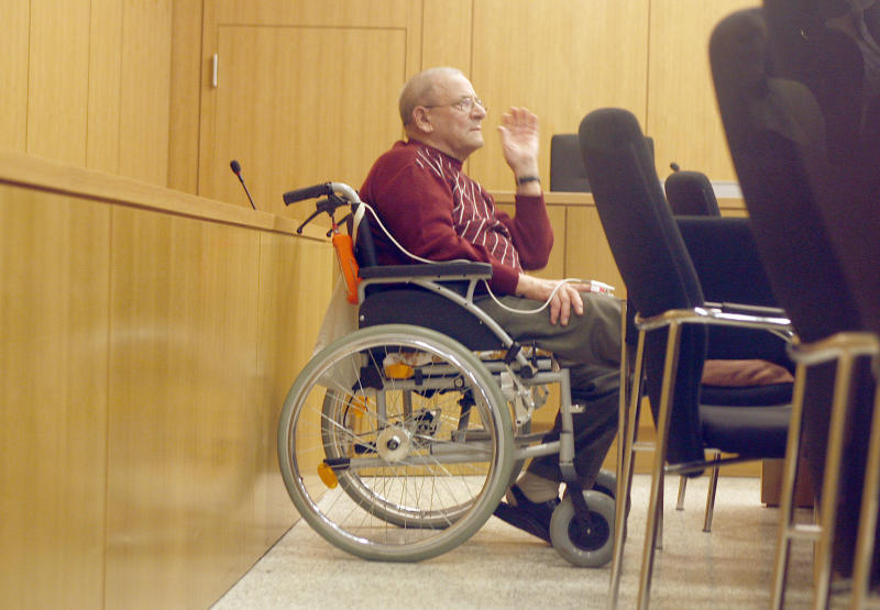 FILE - The March 23, 2010 file photo shows former member of Adolf Hitler's Waffen SS, Heinrich Boere, in his wheelchair during his trial in the courtroom of the court in Aachen, Germany. German justice officials said Monday, Dec. 2, 2013 Heinrich Boere, who murdered Dutch civilians as part of a Nazi Waffen SS hit squad during World War II but avoided justice for six decades, has died in a prison hospital. He was 92. (AP Photo/Frank Augstein)