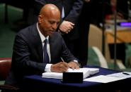 FILE PHOTO: Belize Prime Minister Dean Barrow signs the Paris Agreement on climate change at United Nations Headquarters in New York