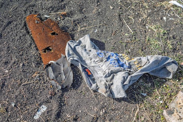 Clothing lies on the ground at the crash scene of an Ethiopian Airlines flight crash near Bishoftu, or Debre Zeit, south of Addis Ababa, Ethiopia, Monday, March 11, 2019. (Photo: Mulugeta Ayene/AP)