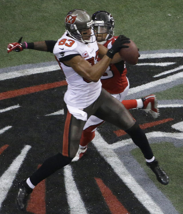 Tampa Bay Buccaneers wide receiver Vincent Jackson (83) makes a touch-down catch against Atlanta Falcons free safety Thomas DeCoud (28) during the second half of an NFL football game, Sunday, Oct. 20, 2013, in Atlanta. (AP Photo/David Goldman)