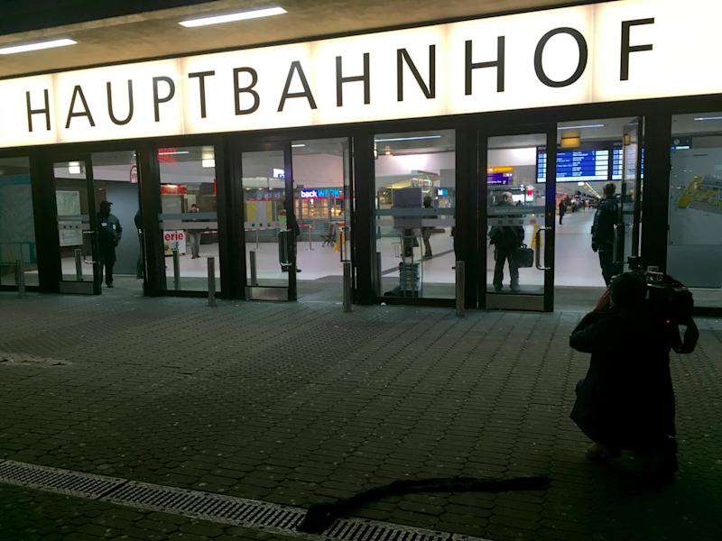 A cameraman films the entrance of the Duesseldorf main train station March 9, 2017 after a man attacked several people at the train station.
