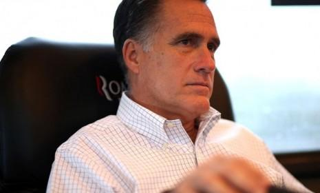 Mitt Romney sits on his campaign bus on Oct. 29 en route to a rally in Avon Lake, Ohio: The Republican presidential nominee canceled his campaign events Monday and Tuesday due to Hurricane Sandy.
