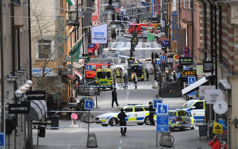 A general view of emergency services in central Stockholm after a truck crashed into a department store - TT NEWS AGENCY