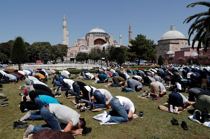 FILE PHOTO: Worshippers attend Friday prayers outside Hagia Sophia Grand Mosque in Istanbul