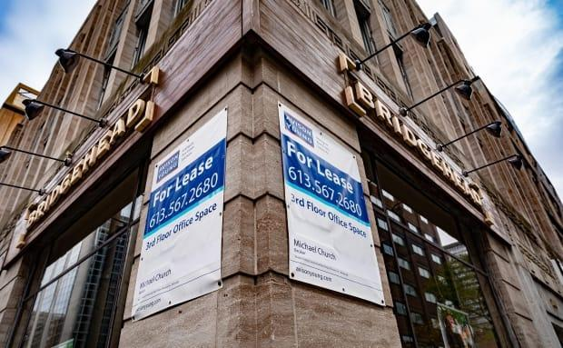 A 'For Lease' sign on a building on Bank Street in Ottawa in October 2020 advertises vacant office space. According to Altus Group, office availability in the city increased from 8.8 per cent in the last quarter of 2019 to 10 per cent in the fourth quarter of 2020.