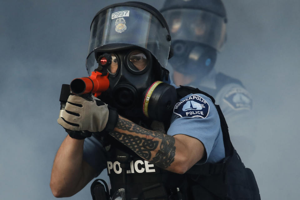 In this image released by World Press Photo, Thursday April 15, 2021, by John Minchillo, Associated Press, part of a series titled Minneapolis Unrest: The George Floyd Aftermath, which won third prize in the Spot News Stories category, shows Police fire tear gas on demonstrators at the intersection of East Lake Street and Hiawatha Avenue in St Paul, Minnesota, USA, on May 29, 2020, near the precinct station of the officers who arrested George Floyd. (John Minchillo, Associated Press, World Press Photo via AP)