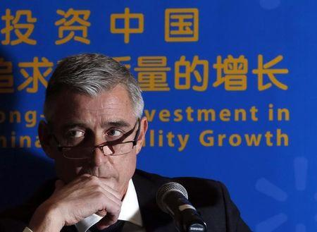 Chief Executive Officer of Wal-Mart China Greg Foran attends a news conference in Beijing