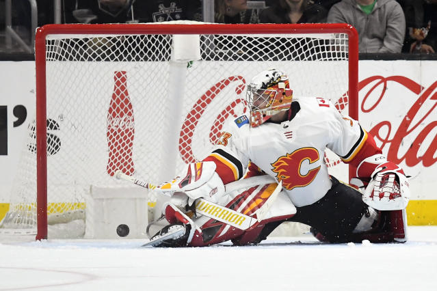 Calgary Flames goaltender David Rittich gives up a goal to Los Angeles Kings center Jeff Carter during the third period of an NHL hockey game Wednesday, Feb. 12, 2020, in Los Angeles. The Kings won 5-3. (AP Photo/Mark J. Terrill)