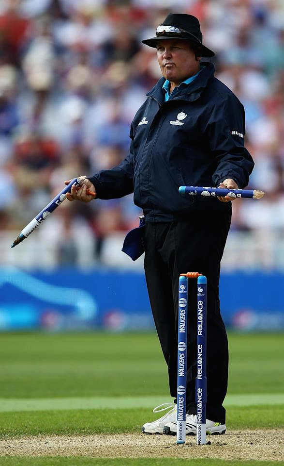 BIRMINGHAM, ENGLAND - JUNE 08:  Umpire Marais Erasmus looks on, after a stump was broken by a throw from James Anderson of England during the ICC Champions Trophy Group A match between England and Australia at Edgbaston on June 8, 2013 in Birmingham, England.  (Photo by Matthew Lewis-ICC/ICC via Getty Images)