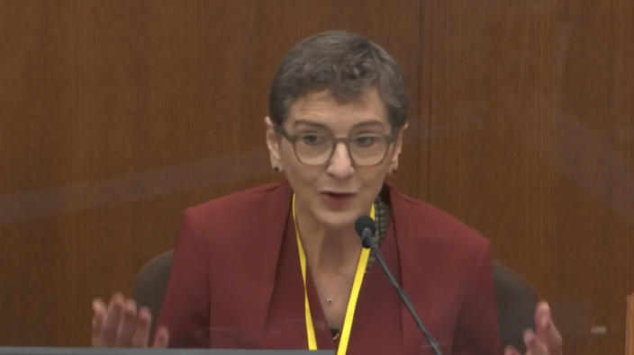 In this image from video, Dr. Lindsey Thomas, a forensic pathologist, now retired, testifies as Hennepin County Judge Peter Cahill presides, Friday, April 9, 2021, in the trial of former Minneapolis police Officer Derek Chauvin at the Hennepin County Courthouse in Minneapolis, Minn. Chauvin is charged in the May 25, 2020 death of George Floyd. (Court TV via AP, Pool)