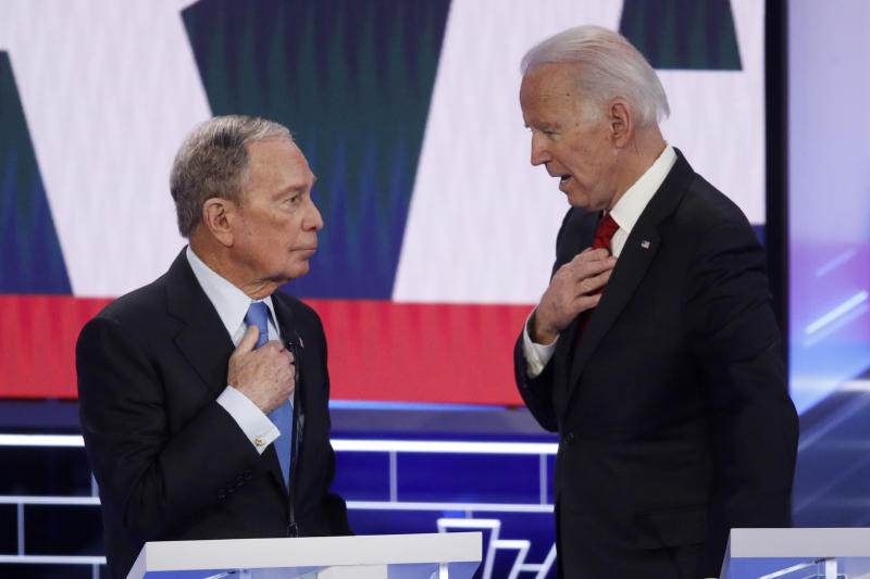 Democratic presidential candidates, former New York City Mayor Mike Bloomberg, left, and former Vice President Joe Biden talk during a break in a Democratic presidential primary debate Wednesday, Feb. 19, 2020, in Las Vegas, hosted by NBC News and MSNBC. (AP Photo/John Locher)