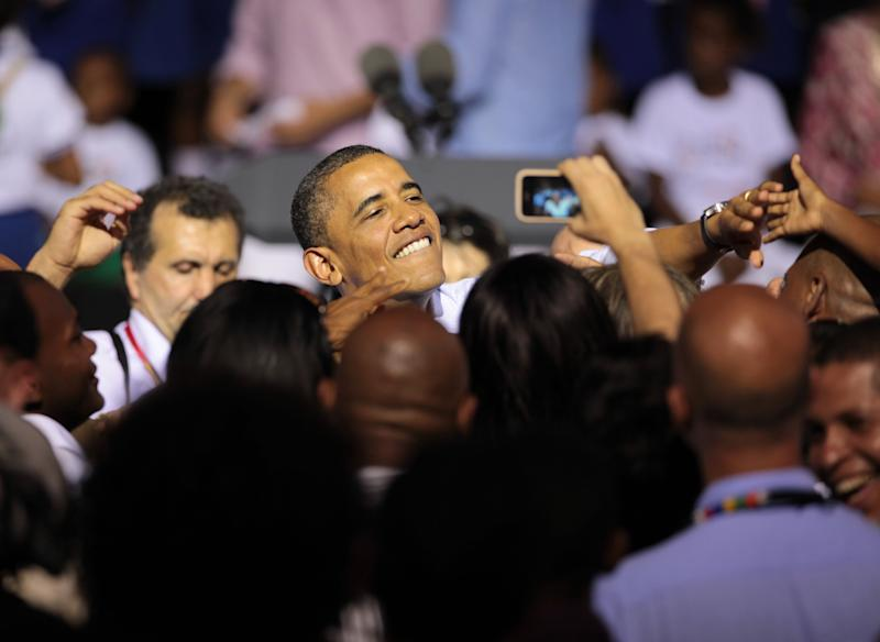 President Barack Obama, center, greets people during a land titling event for Afro-Colombian communities in Cartagena, Colombia, Sunday April 15, 2012. (AP Photo/Fernando Llano)