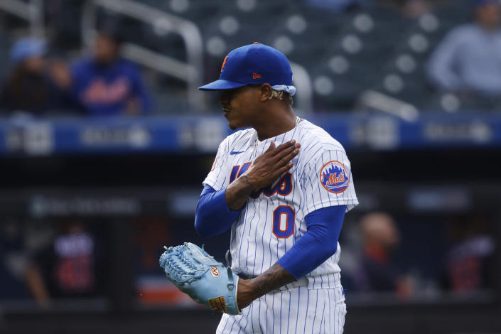 New York Mets' Marcus Stroman reacts as he walks off the mound after giving up a run to the Washington Nationals during the first inning of a baseball game, April 24, 2021, in New York. (AP Photo/Jason DeCrow)