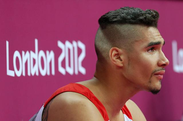 LONDON, ENGLAND - JULY 28: Louis Smith of Great Britain reacts after the hearing his score in the pommel horse in the men's qualification session for Artistic Gymnastics Men's Team on day one of the London 2012 Olympic Games at North Greenwich Arena on July 28, 2012 in London, England. (Photo by Ronald Martinez/Getty Images)