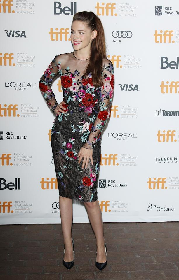 "BEST: We're sure Kristen Stewart was pretty nervous to come to the TIFF premiere of ""On The Road,"" her first public appearance since her cheating scandal broke in July. But the ""Twilight"" star totally rocked the red carpet in this Zuhair Murad dress that features a sheer neckline and beautiful floral appliqué detailing."