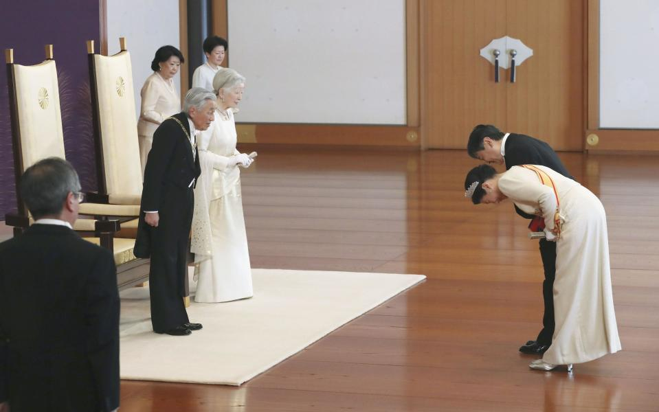Japanese Emperor Akihito, second from left, and Empress Michiko, third from left, are greeted by Crown Prince Naruhito, right, and Crown Princess Masako, second from right, during a ceremony in the celebration of New Year at the Imperial Palace in Tokyo, Tuesday. Jan. 1, 2019. (Kyodo News via AP)