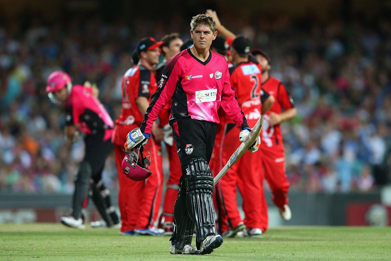 SYDNEY, AUSTRALIA - JANUARY 09: Daniel Hughes of the Sixers walks off the field after being dismissed by Will Sheridan of the Renegades during the Big Bash League match between the Sydney Sixers and the Melbourne Renegades at SCG on January 9, 2013 in Sydney, Australia.  (Photo by Cameron Spencer/Getty Images)