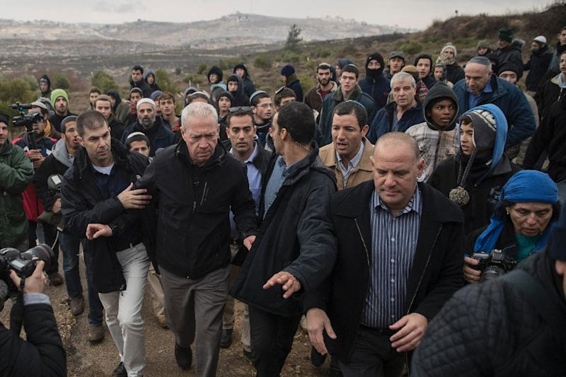 Israeli Housing Minister Yoav Galant (C-L) visits the settlement outpost of Amona, which was established in 1997 and built on private Palestinian land, in the Israeli-occupied West Bank on December 18, 2016 (AFP Photo/JACK GUEZ)
