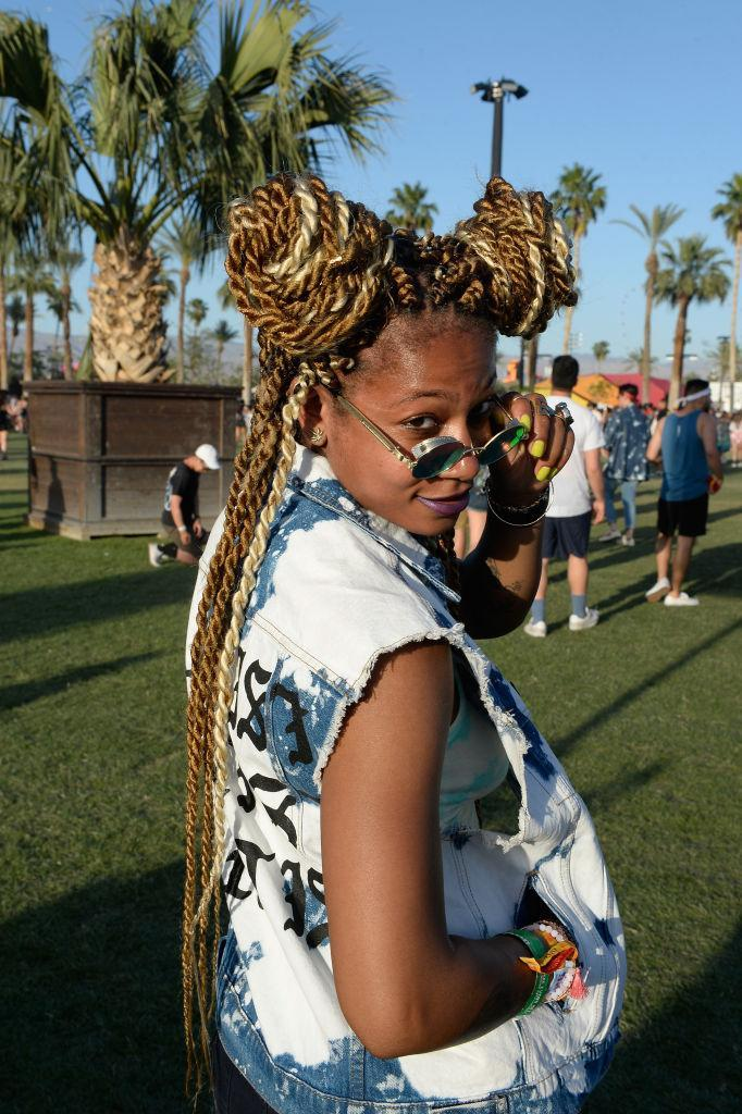 <p>A festivalgoer rocks two-strand twisted topknots with blond highlights. (Photo: Matt Cowan/Getty Images for Coachella) </p>