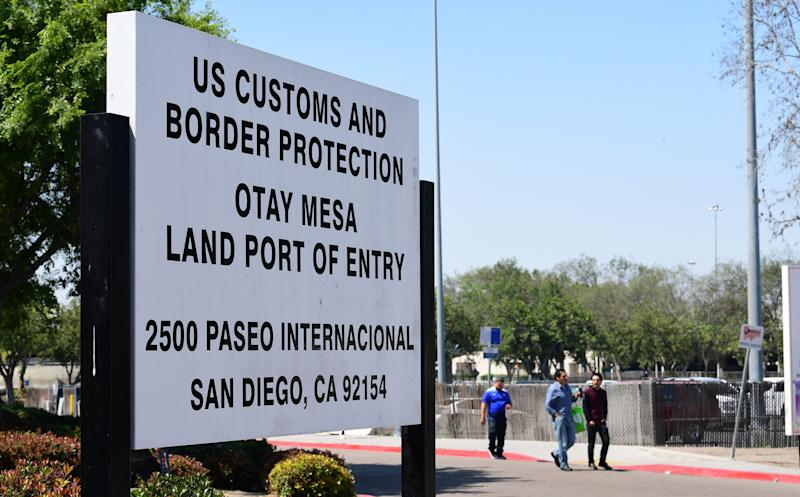 People enter the US at the Otay Mesa port of entry at the US-Mexico border in San Diego, California on June 8, 2019. - US President Donald Trump touted on Saturday his last-minute deal averting tariffs on Mexico, a plan economists warned would have been disastrous for both countries, saying the agreement will be a big success if America's southern neighbor cracks down on illegal immigration as promised. (Photo by Frederic J. BROWN / AFP) (Photo credit should read FREDERIC J. BROWN/AFP/Getty Images)