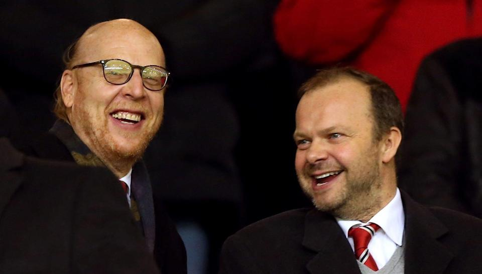 Joel Glazer, left, pictured with loyal executive Ed Woodward (PA)