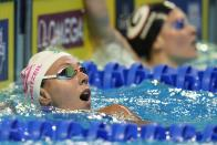 Abbey Weitzeil after winning the women's 100 freestyle during wave 2 of the U.S. Olympic Swim Trials on Friday, June 18, 2021, in Omaha, Neb. (AP Photo/Jeff Roberson)