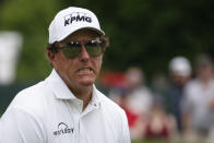 Phil Mickelson reacts after missing a putt on the ninth green during the final round of the Travelers Championship golf tournament at TPC River Highlands, Sunday, June 27, 2021, in Cromwell, Conn. (AP Photo/John Minchillo)