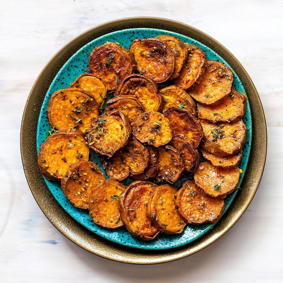 <p>This savory spin on sweet potatoes uses earthy herbs and aromatics to help cut through the sweetness of the spuds, creating a beautifully balanced dish. Leaving the skins on helps the sweet potatoes retain some texture after being roasted, but they work just as well peeled. Look for sweet potatoes that are similar in diameter, which will help them cook at the same rate, and try smoked paprika instead of sweet to give them even more of a savory edge.</p>