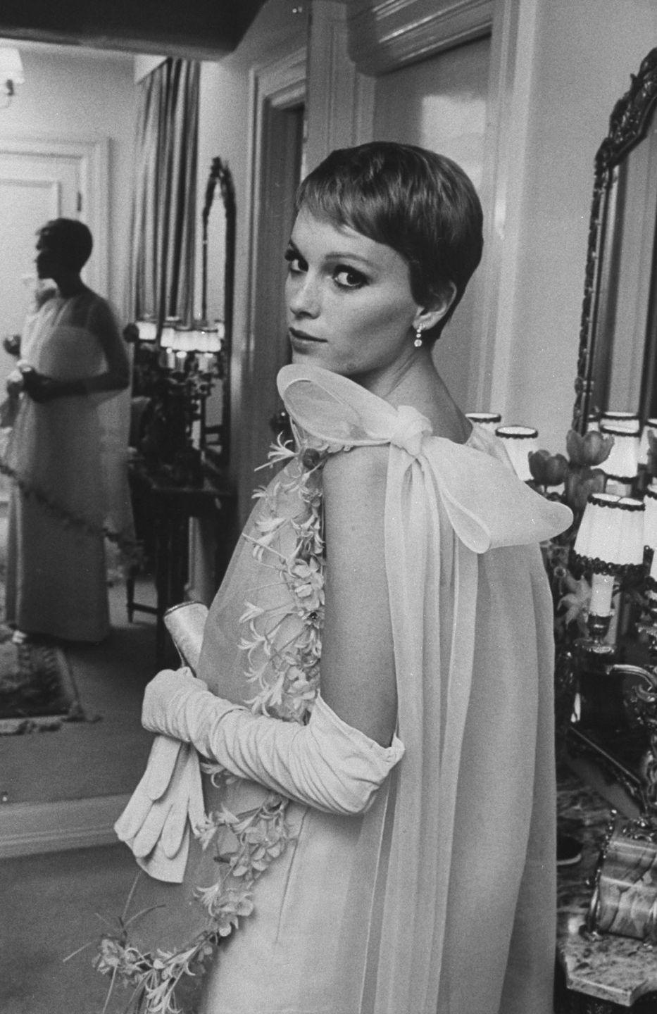 <p>From her modern pixie cut to her elegant style, Farrow was one of the decade's greatest style icons. Here, she dons a couture gown by French designer Pierre Cardin in Sinatra's New York City townhouse. </p>