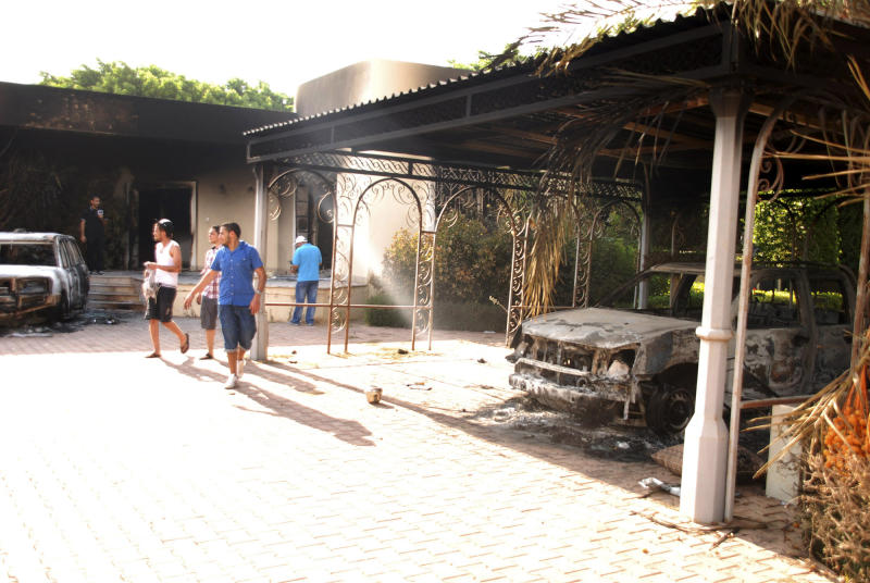 FILE - This Sept. 12, 2012 file photo shows Libyans walking on the grounds of the gutted U.S. consulate in Benghazi, Libya, after an attack that killed four Americans, including Ambassador Chris Stevens. An independent panel appointed by Secretary of State Hillary Rodham Clinton is opening its inquiry into the attack on the U.S. consulate in Benghazi, Libya, amid demands from Congress for speedy answers to questions about the security of the mission and concerns that the FBI investigation into the incident has been delayed. (AP Photo/Ibrahim Alaguri, File)