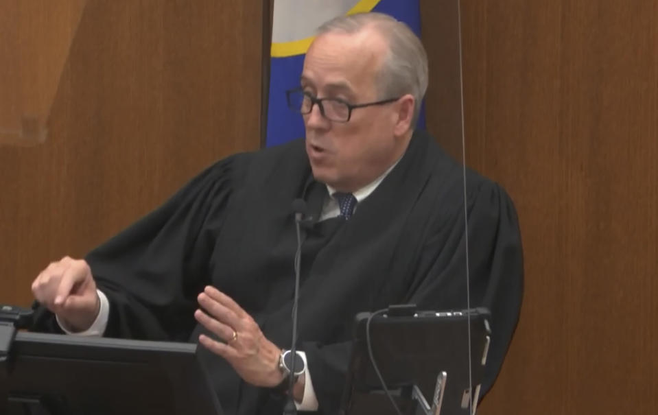 In this image from video, Hennepin County Judge Peter Cahill dresses the court after the judge put the trial into the hands of the jury. Monday, April 19, 2021, in the trial of Chauvin, in the May 25, 2020, death of George Floyd at the Hennepin County Courthouse in Minneapolis, Minn. (Court TV via AP, Pool)