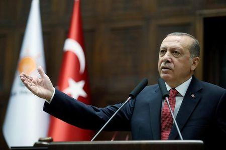 Turkish President Erdogan addresses members of parliament from his ruling AK Party during a meeting at the parliament in Ankara