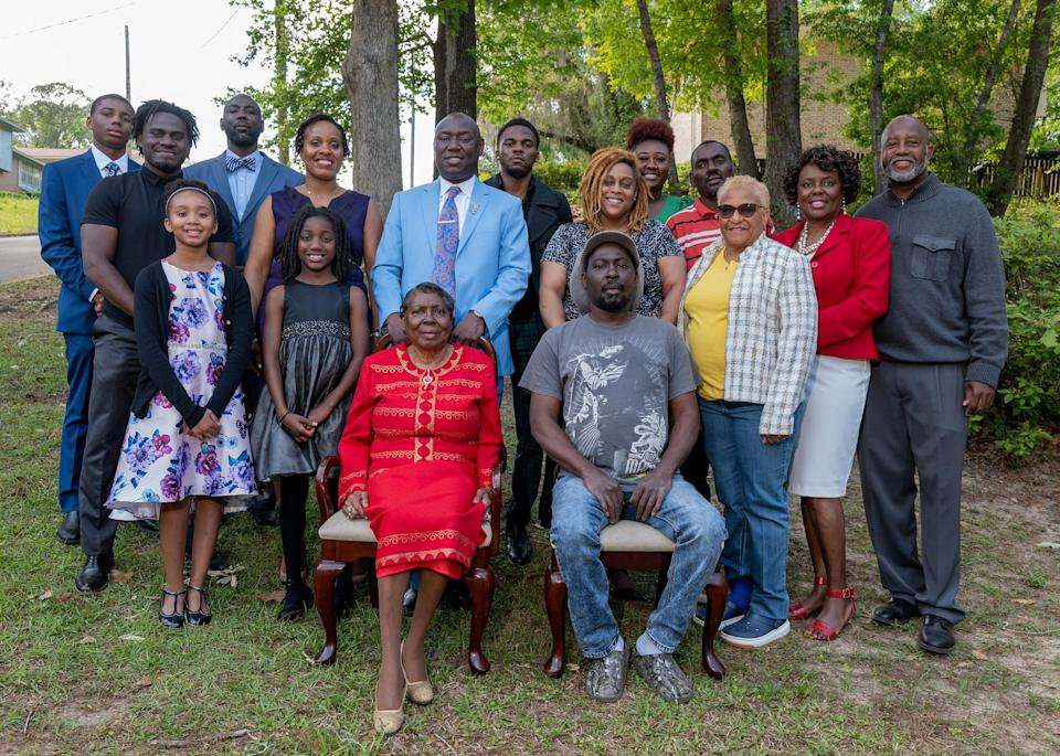 """Crump stands behind his mother as the family poses for a photo on Easter Sunday, in Tallahassee, Fla., on April 4.<span class=""""copyright"""">Ruddy Roye for TIME</span>"""