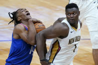New Orleans Pelicans forward Zion Williamson (1) tries to stop LA Clippers guard Terance Mann (14) from reaching the basket in the first half of an NBA basketball game in New Orleans, Monday, April 26, 2021. (AP Photo/Gerald Herbert)