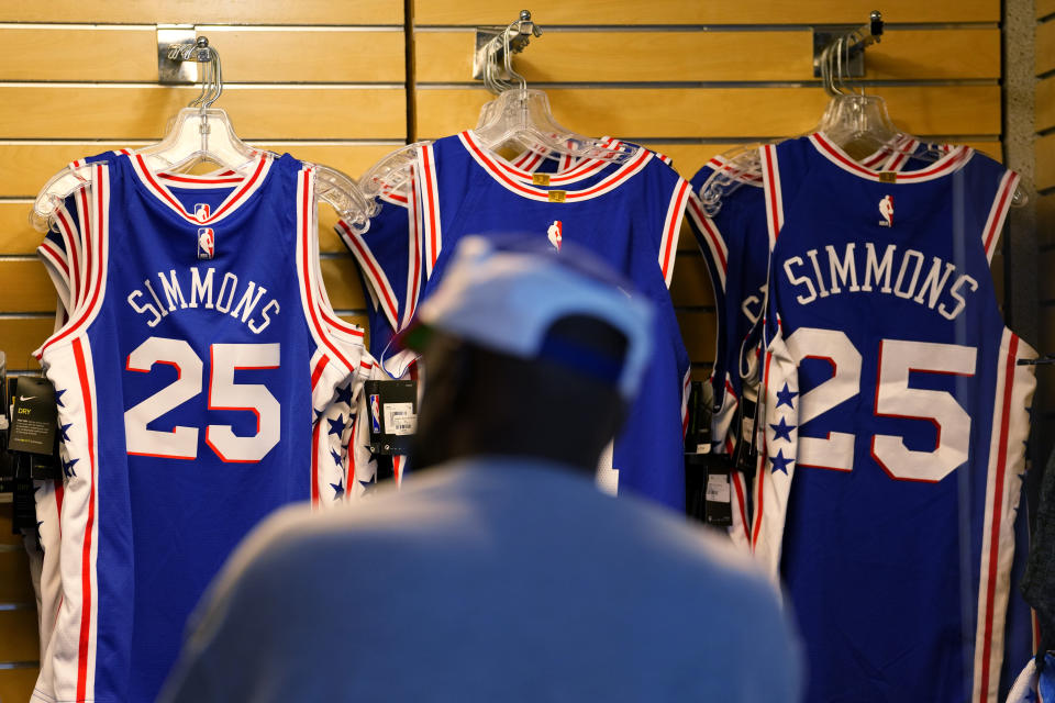 A fan shops for souvenirs before a preseason NBA basketball game between the Philadelphia 76ers and the Toronto Raptors, Thursday, Oct. 7, 2021, in Philadelphia. Ben Simmons was out of sight, out of mind and out of the team pregame hype video for the Philadelphia 76ers. The Sixers have largely stopped talking about the three-time All-Star guard. (AP Photo/Matt Slocum)