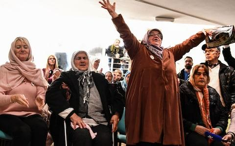 Mothers of Srebrenica's victims clapped when the convictions were read out - Credit:  AFP