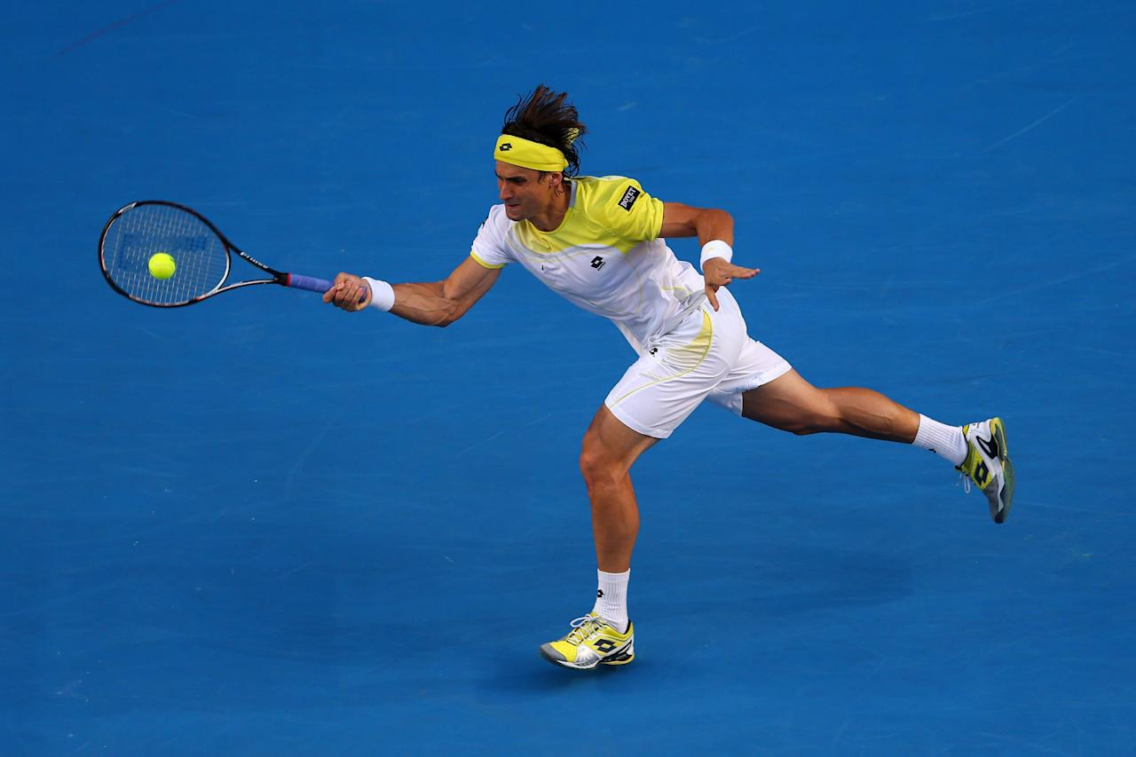 MELBOURNE, AUSTRALIA - JANUARY 14:  David Ferrer of Spain plays a forehand in his first round match against Olivier Rochus of Belgium during day one of the 2013 Australian Open at Melbourne Park on January 14, 2013 in Melbourne, Australia.  (Photo by Julian Finney/Getty Images)