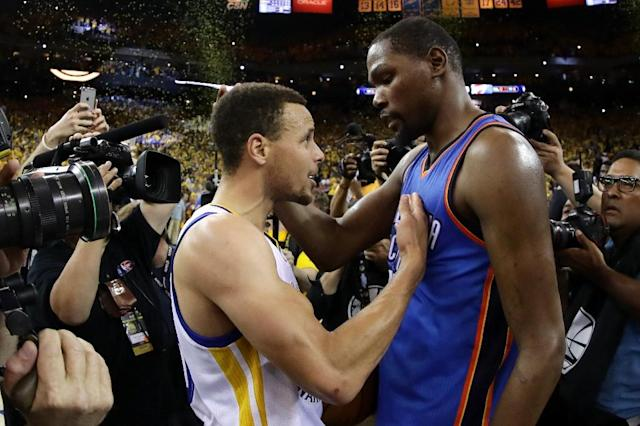 Stephen Curry of the Golden State Warriors (L) and Kevin Durant of the Oklahoma City Thunder, pictured on May 30, 2016, became friends while they were teammates on the US world championship squad in 2010 (AFP Photo/Ezra Shaw)