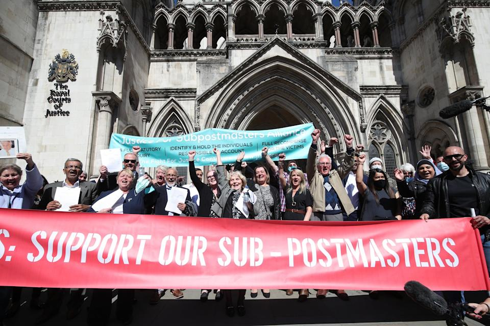 Former post office workers celebrating outside the Royal Courts of Justice (Yui Mok/PA) (PA Wire)