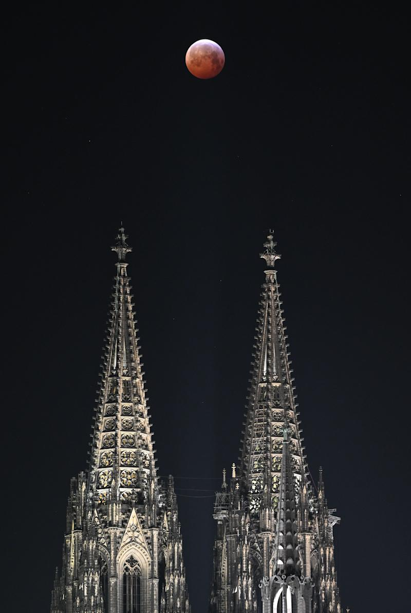 The super blood moon above a cathedral in Cologne, Germany, Jan. 21.