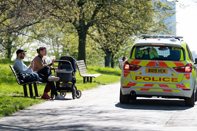 EMBARGOED TO 0001 WEDNESDAY JULY 1 File photo dated 5/4/2020 of police stop to move on a couple with a push chair on Primrose Hill, London. Wednesday marks 100 days since first full day of UK lockdown and six months since China alerted WHO to Wuhan cases.