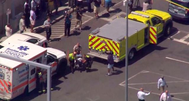 <p>A screengrab of the scene where a cab jumped a curb striking several bystanders near the Logan International Airport taxi pool in Boston, MA, July 3, 2017. (ABC News) </p>